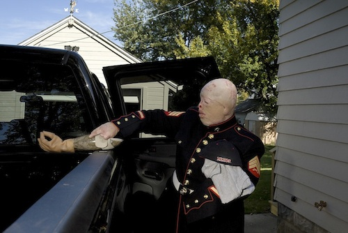 nina_berman_ty_carries_his_arm_into_his_pick-up_truck_2006